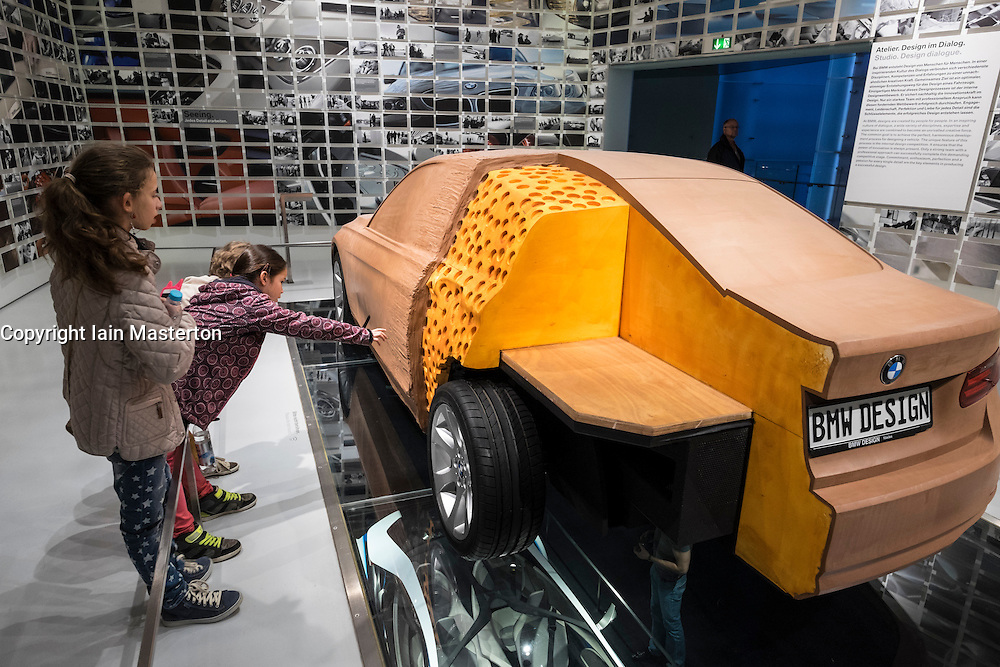 Visitors examine car design model at BMW Museum in Munich Germany