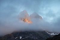 Mountain peaks emerge from clouds, Moskenesøy, Lofoten Islands, Norway