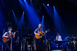 """© Licensed to London News Pictures. 08/11/2012. London, UK.   Bon Iver performing live at Wembley Arena. Bon Iver are a Grammy award-winning American folk band founded in 2007 by indie folk singer-songwriter Justin Vernon (centre). In addition to Vernon the band includes Michael Noyce, Sean Carey and Matthew McCaughan.  The name Bon Iver is derived from the French phrase bon hiver, meaning """"good winter"""" or """"have a good winter"""".Photo credit : Richard Isaac/LNP"""