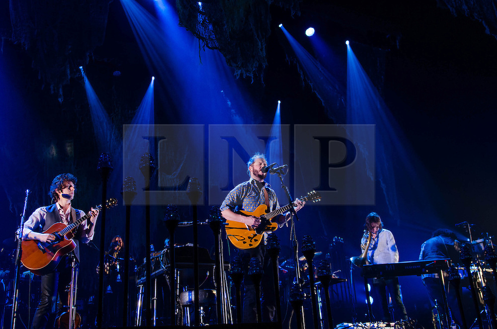 "© Licensed to London News Pictures. 08/11/2012. London, UK.   Bon Iver performing live at Wembley Arena. Bon Iver are a Grammy award-winning American folk band founded in 2007 by indie folk singer-songwriter Justin Vernon (centre). In addition to Vernon the band includes Michael Noyce, Sean Carey and Matthew McCaughan.  The name Bon Iver is derived from the French phrase bon hiver, meaning ""good winter"" or ""have a good winter"".Photo credit : Richard Isaac/LNP"