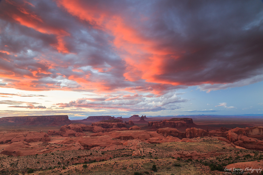 A vivid sunset over Monument Valley Navajo Tribal Park, viewed from atop Hunt's Mesa, Arizona