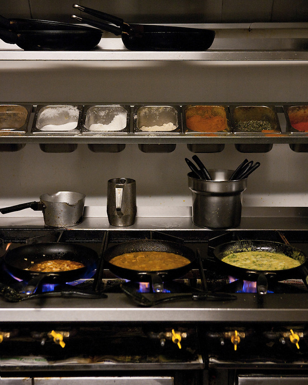 Cooking at a Indian take away kitchen with spices