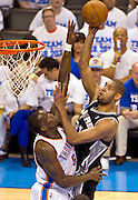 June 2, 2012; Oklahoma City, OK, USA; Oklahoma City Thunder center Kentrick Perkins (5) attempts to block a shot taken by San Antonio Spurs forward Tim Duncan (21) during the second half of a playoff game at Chesapeake Energy Arena.  Thunder defeated the Spurs 109-103 Mandatory Credit: Beth Hall-US PRESSWIRE