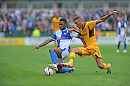 Christian Jolley of Newport County challenges Ellis Harrison of Bristol Rovers (l) Skybet League two match, Newport county v Bristol Rovers at Rodney Parade in Newport, South Wales on Saturday 17th August 2013.  pic by Phil Rees ,Andrew Orchard sports photography,