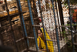 Kanchan Singadiy waits to speak to a health worker at the Thakkar Bappa DOTS clinic.  She has to leave town to attend a funeral and wants to get a 2 week supply of medicine to take with her.