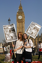 Schoolchildren taking part in anti war in Iraq protest outside Houses of Parliament; February 2003 London UK