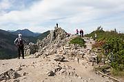 Polish hikers rest at the top of Sarnia Skala, a mountain in the Tatra National Park, on 16th September 2019, near Koscielisko, Zakopane, Malopolska, Poland.