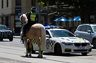 A Mounted Police Officer liaises with Highway Patrol during an Extinction Rebellion protest in Melbourne.  A small group of climate protesters marched from Flagstaff Gardens to The Queen Victoria Market and ending with two individuals gluing themselves together, and then glued themselves to Victoria Avenue outside of the Market. This comes as 5 new COVID-19 cases were uncovered in Melbourne's revamped Hotel Quarantine, breaking almost 40 days of virus free days. (Photo by Dave Hewison/Speed Media)