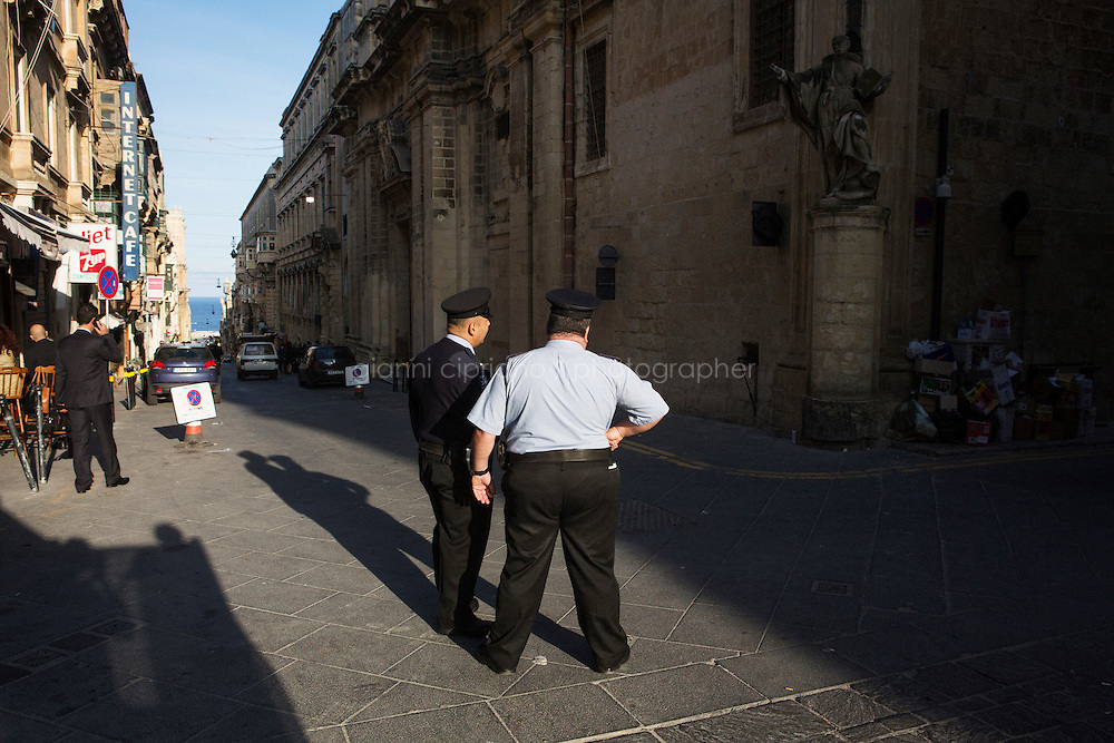 VALLETTA, MALTA - 7 DECEMBER 2015: Overweight police officers are here in Valletta, Malta, on December 7th 2015. Malta hasthe highest overweight and obesity rates in the European Union, according to a report from the World Health Organisation.