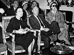 File photo dated 2/6/1953 of the Duke and Duchess of Windsor watch the coronation of Queen Elizabeth II on the television screen at the Paris home of Mrs. Margaret Biddle (right), the American millionairess. Almost 70 years ago an abdicated king returned from the US for a royal funeral, while his American wife was absent. Issue date: Thursday April 15, 2021.