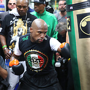 LAS VEGAS, NV - APRIL 14: WBC/WBA welterweight champion Floyd Mayweather Jr. pounds the heavy bag as he works out at the Mayweather Boxing Club on April 14, 2015 in Las Vegas, Nevada. Mayweather will face WBO welterweight champion Manny Pacquiao in a unification bout on May 2, 2015 in Las Vegas.  (Photo by Alex Menendez/Getty Images) *** Local Caption *** Floyd Mayweather Jr.