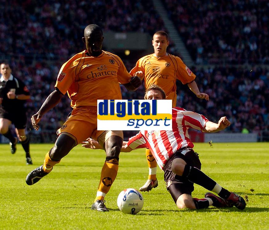 Photo: Jed Wee/Sportsbeat Images.<br /> Sunderland v Wolverhampton Wanderers. Coca Cola Championship. 07/04/2007.<br /> <br /> Wolves' Seyi Olofinjana (L) is tackled by Sunderland's Danny Collins.