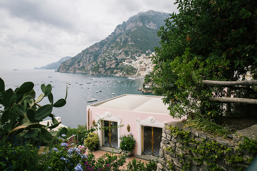 POSITANO, ITALY - 13 SEPTEMBER 2018: A view of the entrance of Villa Tre Ville overlooking Positano, Italy, on September 13th 2018.<br /> <br /> Villa Tre Ville was originally purchased in the 1920s by the Russian writer Mikhail Semenov. Later purchased by the Italian film and opera director Franco Zeffirelli in the 1960s, the property was often visited by dancers, singers, writers, musicians, painters, actors and intellectuals from all over the globe. Among these artists were Liz Taylor, Maria Callas, Leonard Berstein, Laurence Olivier. In 2007 the villa was sold to the hotelier Giovanni Russo. In 2013 Robert Friedland announced that the company's Ivanhoe Italia LLC subsidiary has completed the acquisition of the Villa Tre Ville and that it  would form part of an Ivanhoe group of international boutique hotels and villas, with other locations under development in Thailand and Japan.