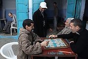 """Some men play a game of parcheesi outside a tea shop in Chefchaouen, Morocco, whose """"medina"""" (old city) is famous for its striking blue walls."""