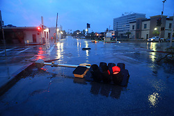 August 26, 2017 - Corpus Christi, Texas, U.S. - A streetlight continues to blink despite being ripped from the ground in downtown Corpus Christi, the morning after Hurricane Harvey hit the Gulf coast. (Credit Image: © Rachel Denny Clow/TNS via ZUMA Wire)