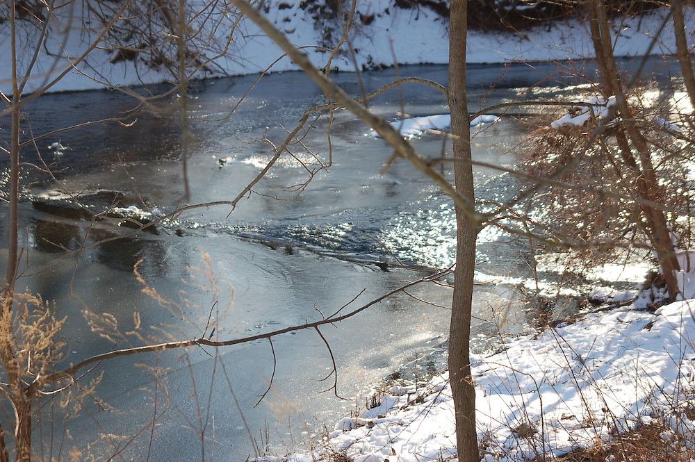 Almost spring, the ice is starting to melt and the water flow