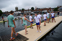 © Licensed to London News Pictures. 28/06/2017. London, UK. Two competing teams shake hands after a race on day one of the Henley Royal Regatta, set on the River Thames by the town of Henley-on-Thames in England.  Established in 1839, the five day international rowing event, raced over a course of 2,112 meters (1 mile 550 yards), is considered an important part of the English social season. Photo credit: Ben Cawthra/LNP
