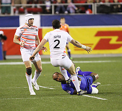 March 4, 2017 - Las Vegas, Nevada, United States of America - English Rugby player Charlie Hayter is tackled by Fijian player Falemiga Selesele during the 2017 USA Sevens International Rugby Tournament game between England and Fiji on March 3, 2017  at Sam Boyd  Stadium  in Las Vegas, Nevada (Credit Image: © Marcel Thomas via ZUMA Wire)