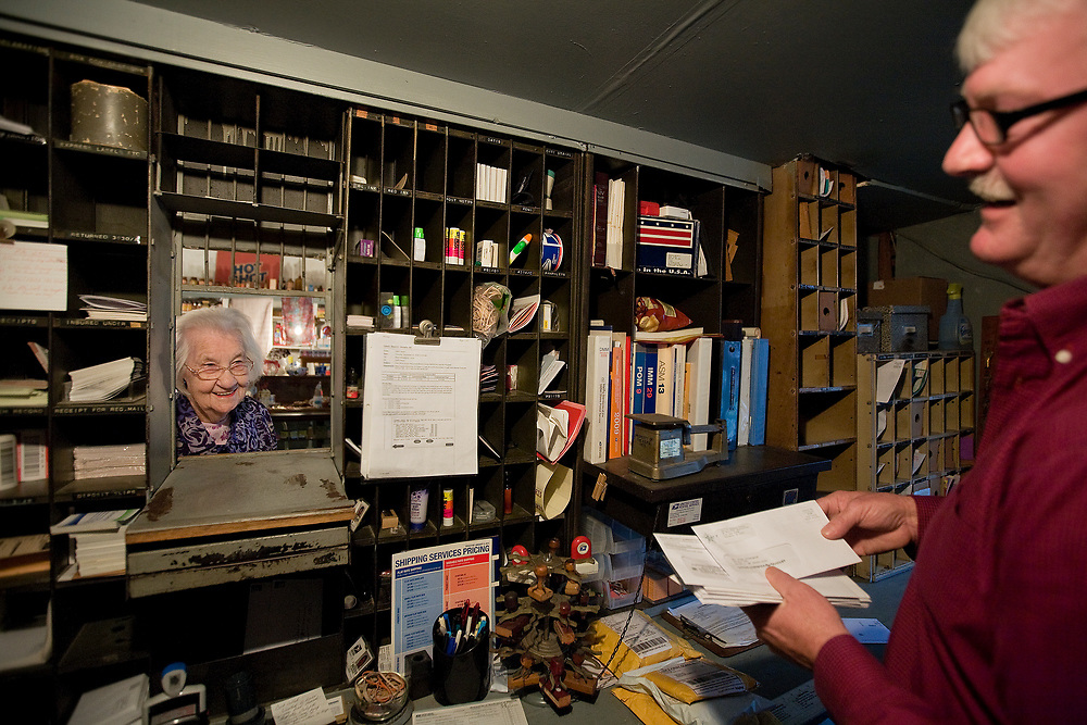 After checking her mail Carrie LeNoir shares a laugh with her son Steve LeNoir as he sorts mail at the Horatio Post Office, which is located inside of their families' general store. Mrs. LeNoir was postmaster of the post office from 1943-1976. Following in his mother's footsteps, Steve has been postmaster since 1981. The post office has operated inside of the store since 1900.