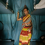 A transgender begging for money. Throughout the journey, peddlers pop into the train compartments with all sorts of offerings,  to be bargained for a few rupees.<br /> Inside the Dibrugarh-Kanyakumari Vivek Express, the longest train route in the Indian Subcontinent. It joins Kanyakumari, Tamil Nadu, which is the southernmost tip of mainland India to Dibrugarh in Assam province, near the border with Burma.