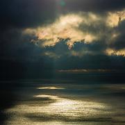 Rays of light as sunrise breaks over Lake Michigan
