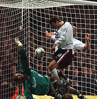 David James (West Ham) blocks a header from Ruud Van Nistelrooy (Man United) in a last minute goalmouth scramble that would have won the game for Man United. West Ham United v Manchester United, FA Premiership, 17/11/2002. Credit: Colorsport / Matthew Impey DIGITAL FILE ONLY