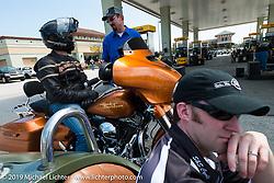 Matt King and Brian Klock gassing up for a ride during Daytona Bike Week. FL, USA. March 11, 2014.  Photography ©2014 Michael Lichter.