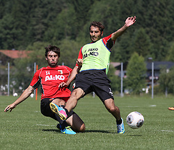 16.07.2013, Trainingsplatz, Walchsee, AUT, 1. FBL, Augsburg Trainingslager, im Bild Kampf um den Ball zwischen Halil ALTINTOP (FC Augsburg #7, 2.v.li.), Sascha M√ñLDERS, MOELDERS (FC Augsburg #33) und Bajram NEBIHI (FC Augsburg #34), Aktion, Zweikampf, // during a Training Session of German Bundesliga Club Augsburg at the Training Ground, Walchsee, Austria on 2013/07/16. EXPA Pictures © 2013, PhotoCredit: EXPA/ Eibner/ Klaus Rainer Krieger<br /> <br /> ***** ATTENTION - OUT OF GER *****