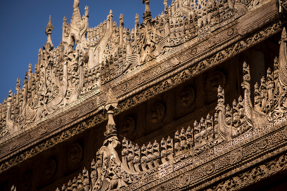 Wooden carved figures on the facade of the Shwenandaw Golden Palace Monastery. Built in 1880 of carved teak, Shwenandaw Monastery was originally part of the imperial palace at Amarapura