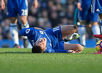 Football - 2016 / 2017 Premier League - Chelsea vs. WBA<br /> <br /> Eden Hazard of Chelsea lies injured after receiving some rough treatment from the WBA team at Stamford Bridge.<br /> <br /> COLORSPORT/DANIEL BEARHAM