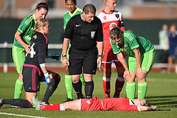 Referee Chris Smith checks welfare of Bristol Academy's Christie Murray following collision with Sunderland AFC Ladies' Hilde Olsen - Mandatory by-line: Paul Knight/JMP - 25/07/2015 - SPORT - FOOTBALL - Bristol, England - Stoke Gifford Stadium - Bristol Academy Women v Sunderland AFC Ladies - FA Women's Super League