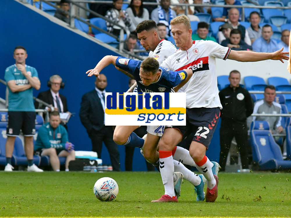 Football - 2019 / 2020 Sky Bet (EFL) Championship - Cardiff City vs. Middlesbrough<br /> <br /> \cso\ brought down by  Marvin Johnson of Middlesbrough  George Saville of Middlesbrough , at the Cardiff City Stadium.<br /> <br /> COLORSPORT/WINSTON BYNORTH