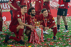 LIVERPOOL, ENGLAND - Wednesday, July 22, 2020: Liverpool's Dejan Lovren, Mohamed Salah and Xherdan Shaqiri celebrate with the Premier League trophy as they are crowned Champions after the FA Premier League match between Liverpool FC and Chelsea FC at Anfield. The game was played behind closed doors due to the UK government's social distancing laws during the Coronavirus COVID-19 Pandemic. Liverpool won 5-3. (Pic by David Rawcliffe/Propaganda)