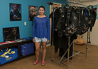 Marketing Manager Nicole Rosas in the scuba supply room of Diversified Dock and Marine Supply's showroom in Gilford.  (Karen Bobotas/for the Laconia Daily Sun)