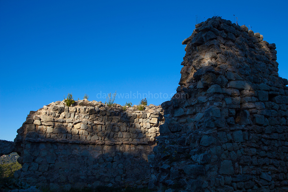 Church ruins at Castell Vell d'Olivella, - the old castle of Olivella. Olivella, Parc Natural de Garraf, Catalonia, Spain. Part of a 10th century defensive system from Christians were trying to recapture Spain from the Muslim rulers.