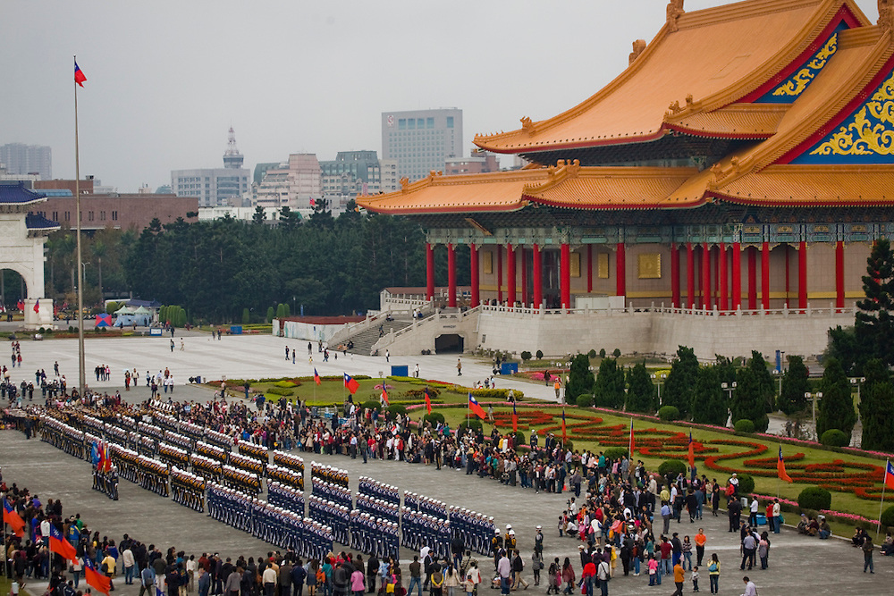 Members of the armed forces practice for ceremonies to mark the founding of The Republic of China and New Year's Day at Freedom Plaza, by Chiang Kai-shek Memorial Hall and National Concert Hall and National Theater.