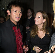 Andy Wong and Emily Oppenheim. David Morris 'Glitter and Glamour party. The Sanderson Hotel, London. 12 December 2000 © Copyright Photograph by Dafydd Jones 66 Stockwell Park Rd. London SW9 0DA Tel 020 7733 0108 www.dafjones.com