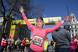 Competitor Aimee Fuller crosses the finish linne during the 2019 London Landmarks Half Marathon.
