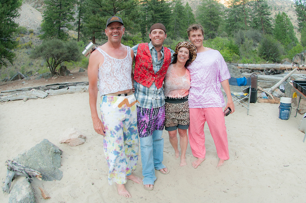 Fun with costumes on party night on the Middle Fork of the Salmon River during six day rafting vacation, Idaho.