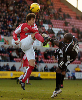 Photo: Alan Crowhurst.<br />Swindon Town v Swansea City. Coca Cola League 1.<br />31/12/2005. <br />Adrian Forbes (R) shoots at goal for Swansea.
