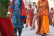 Woman in traditional saris walk through the streets in Jodhpur, Rajasthan, India