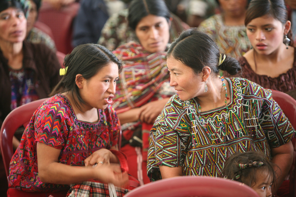Indigenous Maya Ixil omen talk to each other during a forum on food security and eating healthily, organised by CWS partner CIEDEG in Nebaj, Quiche, Guatemala.