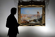 A man looks at the painting, Modern Rome – Campo Vaccino by the British painter JM Turner at Sotheby's auction house. The painting sold for £29,721,150 at the auction at Sotheby's in central London.