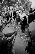 """October 21, 1967, Arlington, VA—Protestors confronting US Army soldiers surrounding the Pentagon with M-1 rifles and sheathed bayonets.Anti-war groupsorganized the large protest forWashington D.C. for October 21, 1967. This demonstration was a rally atWest Potomac Parknear theLincoln Memorialand a march tothe Pentagon.where a rally was held in a parking lot, followed bycivil disobedienceon the steps of the Pentagon itself. The action is known as the """"March on the Pentagon"""" and had an estimated 100,000 participants."""