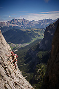 Catching some exposure on the Tridentina / Piscadù via ferrata high above Corvara in the Italian Dolomites. This is one of the more popular via ferrata of the Dolomites given some easy access at the start and the glorious backdrop to the moderate difficulty climb on the way up, taking you from Passo Gardena to the Pisciadù mountain hut (2585m).
