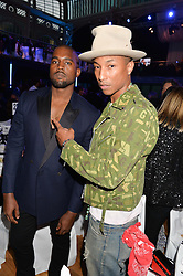 Left to right, KANYE WEST and PHARRELL WILLIAMS at the GQ Men Of The Year 2014 Awards in association with Hugo Boss held at The Royal Opera House, London on 2nd September 2014.