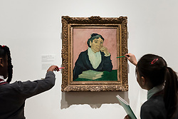 "© Licensed to London News Pictures. 25/03/2019. LONDON, UK. Pupils from Millbank Primary Academy view ""The Arlésienne"", 1890, by Vincent Van Gogh.  Preview of ""The EY: Van Gogh and Britain"" exhibition at Tate Britain, the first exhibition to look at the work of Vincent Van Gogh through his relationship with Britain and how he inspired British artists.  Over 50 of his works are on display 27 March to 11 August 2019.  Photo credit: Stephen Chung/LNP"