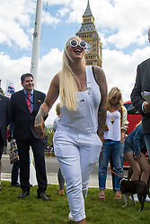 """Westminster, London, May 24th 2016. Animal rights protesters from """"Boycott Dogs4Us"""" protest outside Parliament against puppy farming and third party puppy selling as the Environment, Food and Rural Affairs Sub-Committee are investigating the sale of dogs as part of their animal welfare inquiry. PICTURED: Celebrity guest speaker and dog lover Jodie Marsh"""