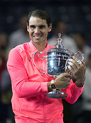 September 10, 2017 - Flushing Meadows, New York, U.S - Rafael Nadal holds his Championship trophy on Day Fourteen of the Men's 2017 US Open Final played against Kevin Anderson at the USTA Billie Jean King National Tennis Center on Sunday September 10, 2017 in the Flushing neighborhood of the Queens borough of New York City. Nadal defeats Anderson, 6-3, 6-3, 6-4. JAVIER ROJAS/PI (Credit Image: © Prensa Internacional via ZUMA Wire)
