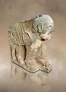 Pictures & images of the North Gate Hittite sculpture statue depicting a mythical winged god with a human head. 8the century BC.  Karatepe Aslantas Open-Air Museum (Karatepe-Aslantaş Açık Hava Müzesi), Osmaniye Province, Turkey. Against art background